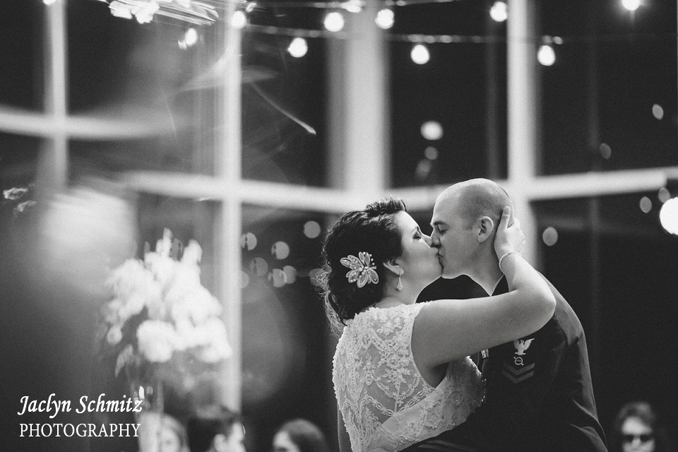coast guard groom and bride in lace first dance hanging light strands